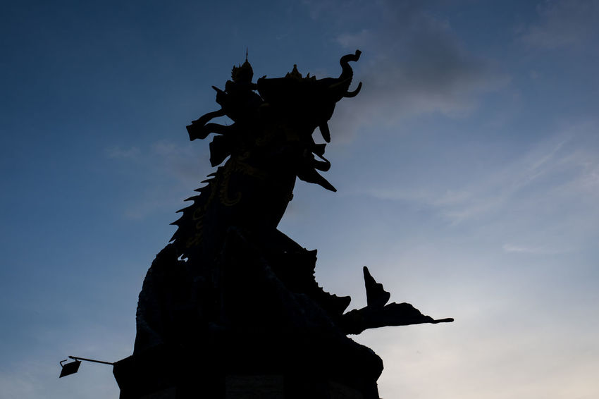 Statue in Canggu Architecture Art And Craft Cloud - Sky Craft Creativity Day History Human Representation Low Angle View Male Likeness Nature No People Outdoors Representation Sculpture Silhouette Sky Statue The Past Travel Destinations