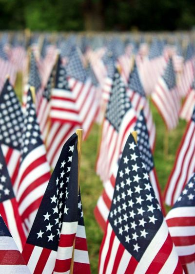 Close-up of american flags at cemetery
