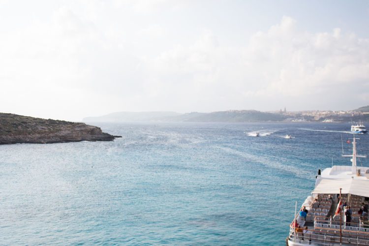 Sea Water Nautical Vessel Sky Transportation Nature Cloud - Sky Scenics - Nature Day Travel Beauty In Nature Mode Of Transportation No People Ship Motion Outdoors Land Journey Tranquil Scene Sailboat Blue Lagoon Malta Comino Island Malta Travel Destinations Travel Photography