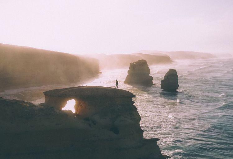 Man walking on rock formation
