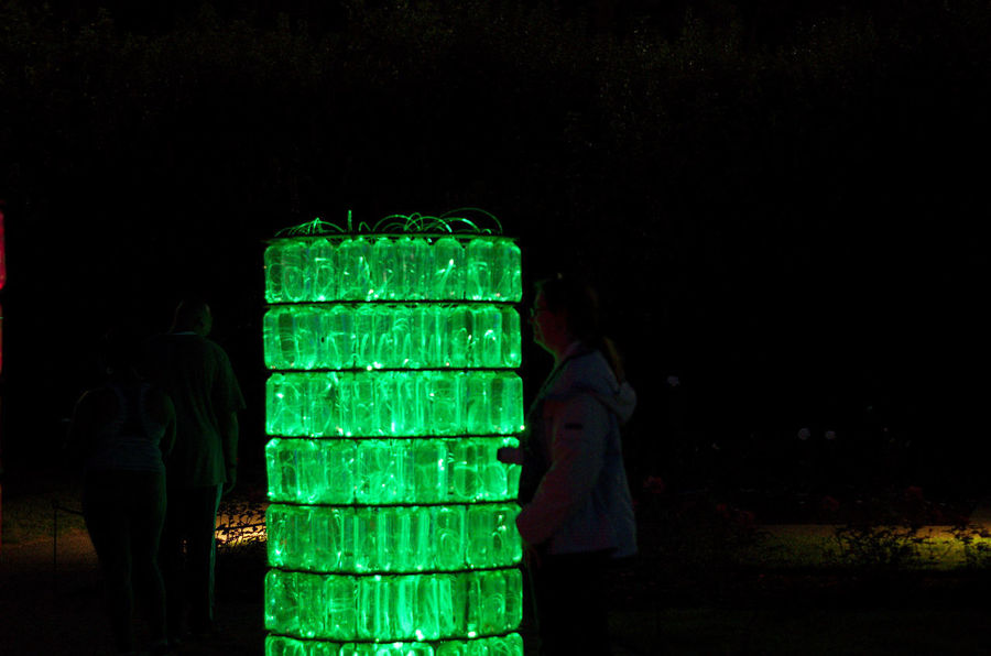 Field of lights Green Color Night Real People Men Illuminated People Lifestyles Women Nature Leisure Activity Standing Land Copy Space Technology Field Two People Dark Outdoors Light - Natural Phenomenon Field Of Lights