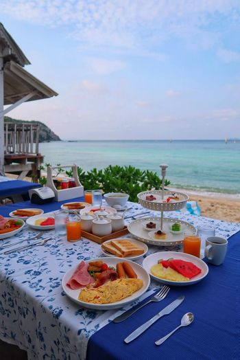 High angle view of food on table at beach against sky