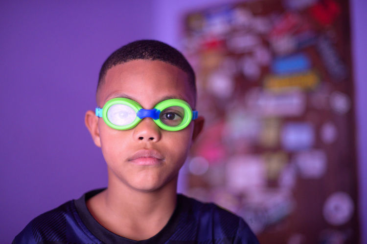 Portrait Of Boy Wearing Swimming Goggles At Home