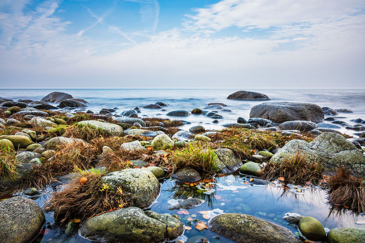 Baltic Sea coast on the island Ruegen, Germany. Baltic Sea Nature Relaxing Rügen Sky And Clouds Travel Boulders Clouds And Sky Coast Journey Landscape Lohme Long Exposure Rocks Ruegen Shore Stones Tourism Travel Destinations Vacation Water