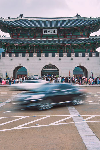 Cars Moving On Road Against Gyeongbokgung