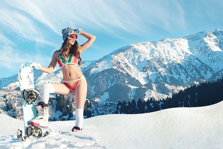 Snow Mountain Leisure Activity Winter Young Women Lifestyles Mountain Range Beauty In Nature Nature Women Adult Vacations Snowcapped Mountain Snowboarding Snowboard Bikini Swimsuit Fashion Freeride Backcountry People Clothing Full Length Outdoors Sport
