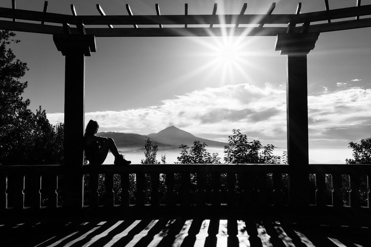 Chilling Silhouette Sitting Wall Woman Architecture Built Structure Cloud - Sky Day Full Length Leisure Activity Lens Flare Lifestyles Men Mountain Nature One Person Outdoors Railing Real People Silhouette Sky Sun Sunbeam Sunlight Tenerife The Great Outdoors - 2018 EyeEm Awards The Traveler - 2018 EyeEm Awards The Portraitist - 2018 EyeEm Awards The Architect - 2018 EyeEm Awards The Street Photographer - 2018 EyeEm Awards Capture Tomorrow