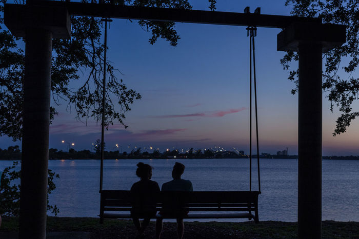 Romantic swing Blue Hour Indian River Lagoon Sunset Indiatlantic, Florida Romantic Romantic Place Serenity Silhouette Swing The Two Of Us  Time Together Tranquil Scene Two People TCPM Young Couple Couple - Relationship Quite Time Quite Moments Togetherness Together Live For The Story Sweethearts