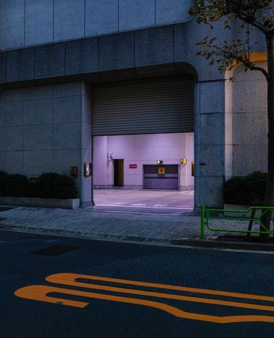 Architecture Sign Built Structure Building Exterior Road Marking Road Symbol Marking Transportation No People City Empty Communication Entrance Street Building Day Outdoors Nature Architectural Column Purple Japan Tokyo