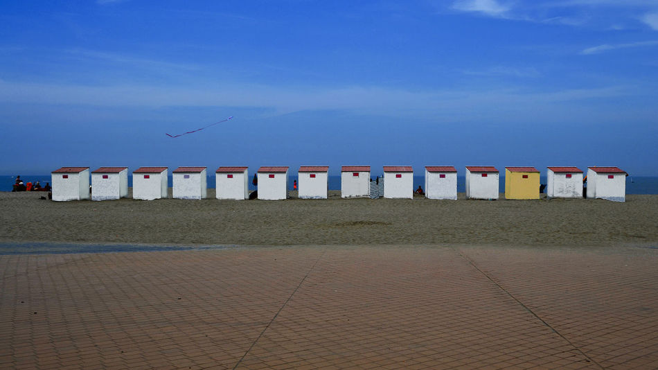 Beach cabins Beach Beach Hut Belgium Blue Built Structure Day In A Row Nature No People Outdoors Sand Sea Sky Vacation