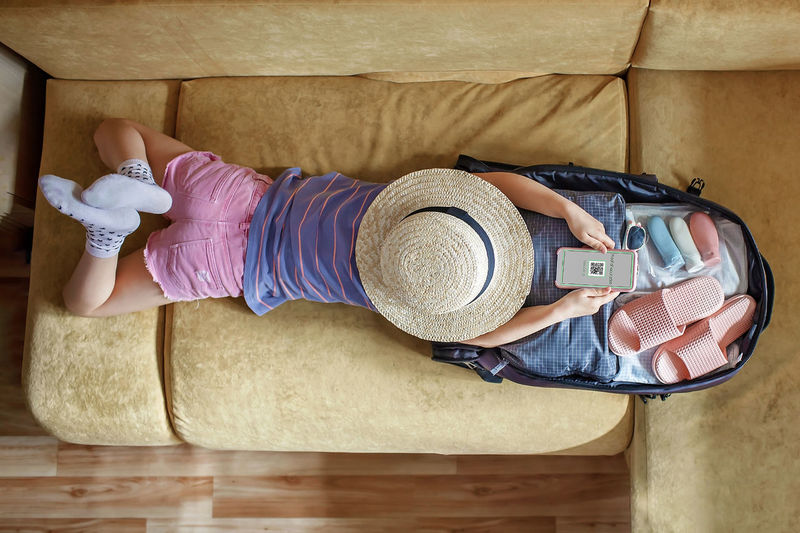 High angle view of woman lying down on floor at home