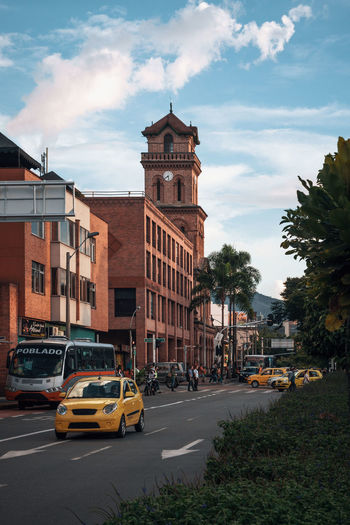 Exploring the city of Medellín. Architecture Building Exterior Built Structure City Nature Outdoors Travel Destinations South America Latin America Explore Urban Car Motor Vehicle Transportation Mode Of Transportation Sky Building Street Cloud - Sky Road Land Vehicle Traffic No People Travel Day Busy Location Poblado Taxi Bus Autobus The Architect - 2019 EyeEm Awards