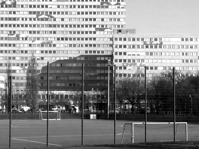 soccer field American Flag Architecture Berlin, Anhalter Bahnhof Building Building Exterior Built Structure City Life Flag Glass Glass - Material Guidance Identity Information Modern National Flag Patriotism Pole Street Light Urban Window