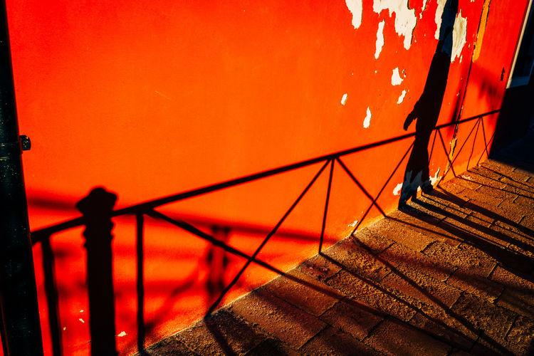 Close-up of railing against orange sky