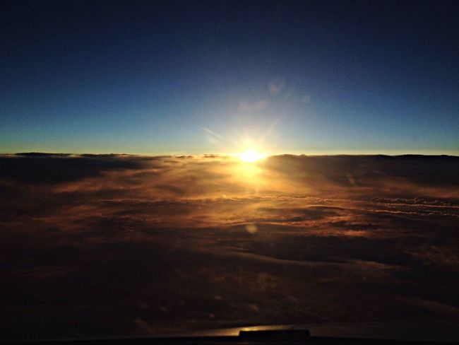 From An Airplane Window 38000 Feet Sunset Clouds And Sky