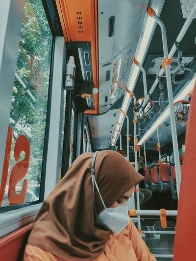 Veiled women wearing masks on the bus