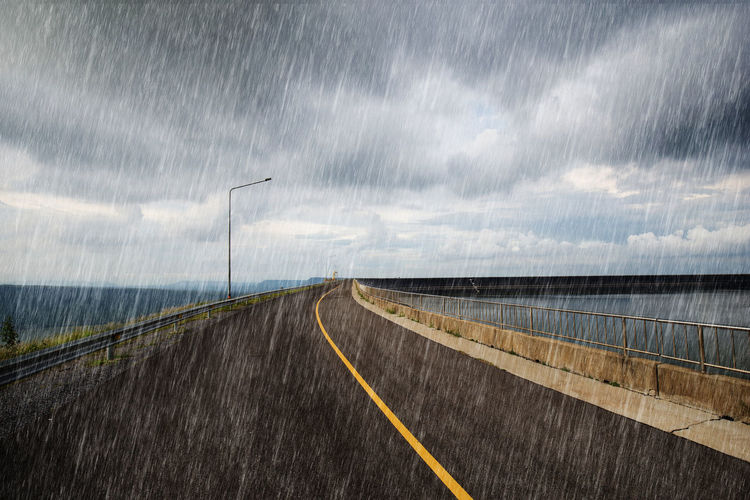 Road Rain Wet Weather Landscape Asphalt Mountain Nature Sky Raining Highway Dark Norway Background Side Summer Empty Scenic Water Heavy Country Green View Travel Fog Outdoor LINE Street Gray Pavement Rainy Black Grey Stormy Curve Dam River Water