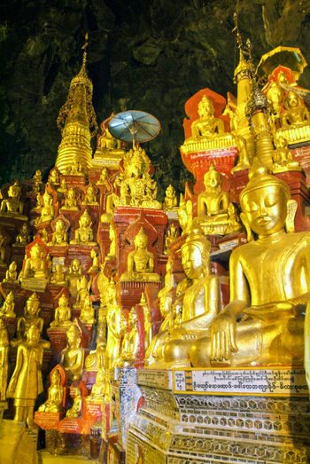 Buddha Golden Burma Day Gold Gold Colored Myanmar No People Outdoors Place Of Worship Religion Sculpture Spirituality Statue Staue