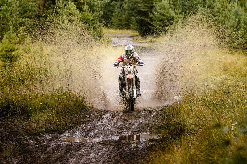 Man riding motorbike in forest
