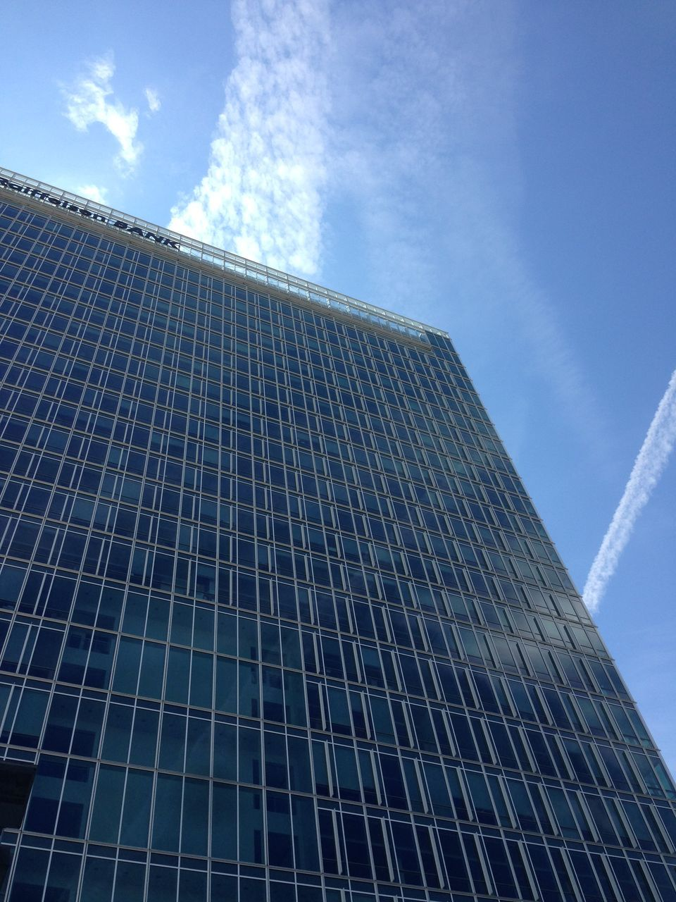 sky, modern, low angle view, architecture, skyscraper, growth, built structure, no people, tall, blue, building exterior, day, city, outdoors
