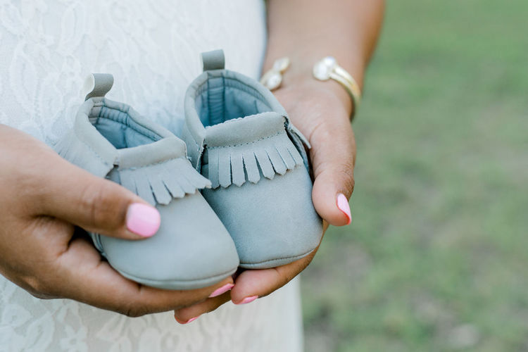 Baby Baby Shoes Babyboy Maternity Motherhood Babygirl Clothing Day Focus On Foreground Holding Human Hand Infant Lifestyles Maternity Photography Maternityshoot  Mocassins Nature Newborn Outdoors Real People Shoes Standing Women