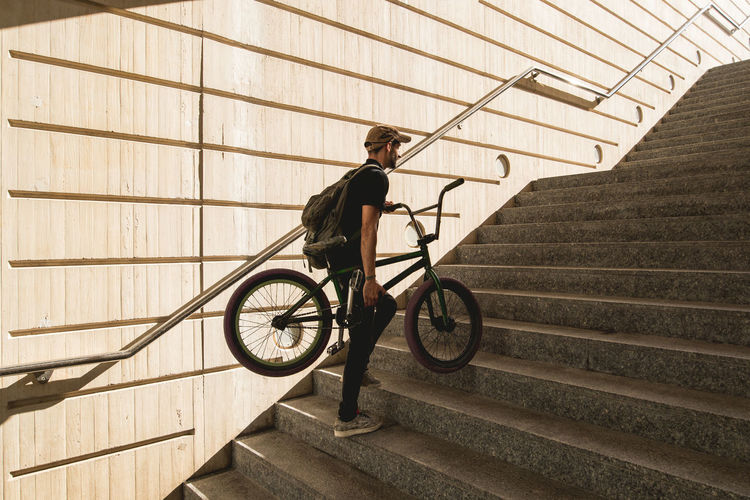 Man riding bicycle on staircase