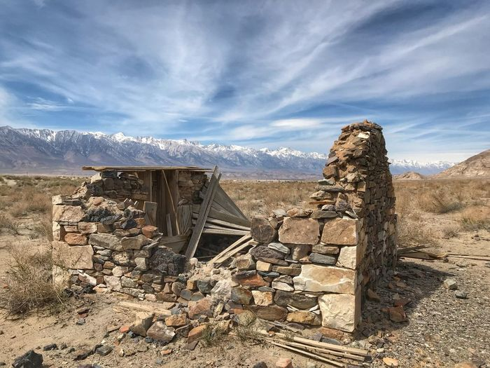 Landscape of stone building in ruin against Sierra Nevada mountains Old Building  Decrepid Ruined Building Sky Cloud - Sky Tranquil Scene Scenics - Nature Nature Tranquility Environment Day No People Landscape Mountain Sunlight Remote Non-urban Scene Sand Outdoors Beauty In Nature Land