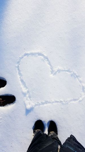 Shoe Lifestyles Personal Perspective Real People Human Leg Shadow Winter Human Body Part Snow Nature Day Outdoors People Close-up Bemyvalentine Love Iloveyou Heart Shape Heart Shaped  Heart Snow Covered Backgrounds