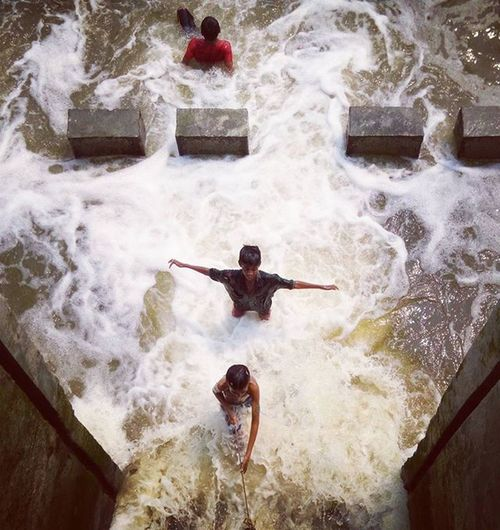On assignment ! Children playing in water that coming through from a sluice gate ! Js Jashimsalam Photojournalism Photographydaily Documentary Life Children Onassignment Climatechange Climate River Canal Play Sports Water Sea Risingsealevel Shundarban Tigers Tigersden Climatechangeisreal Insta Instagood Instagram Bangladesh everydaybangladesh