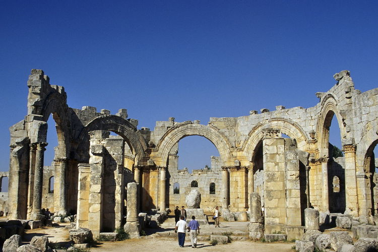 Simeon Stylites church before civil war. Ancient Civilization Arch Arched Architecture Blue Blue Sky Building Exterior Built Structure Church Clear Sky Day History Men Monestary One Person Outdoors People Pilar Real People Saint Simeon Stylites Sky Symeon The Stylite The Past Travel Destinations Women