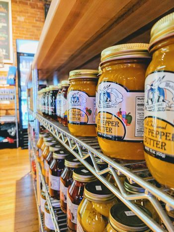 Yellows and mustards Indoors  In A Row No People Food And Drink Warehouse Large Group Of Objects Stack Yellow Mustard Masonjars Marketplace Photography Industrial Building  Shelves