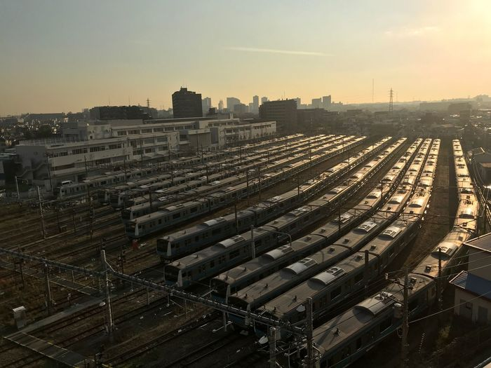 High angle view of trains at shunting yard in during sunset