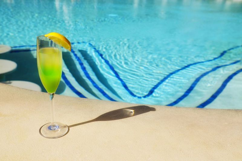 Blue Pool Swimming Pool Water No People Nature Close-up Refreshment Transparent Day Sunlight Shadow Focus On Foreground Poolside Outdoors Yellow Glass Food And Drink Turquoise Colored