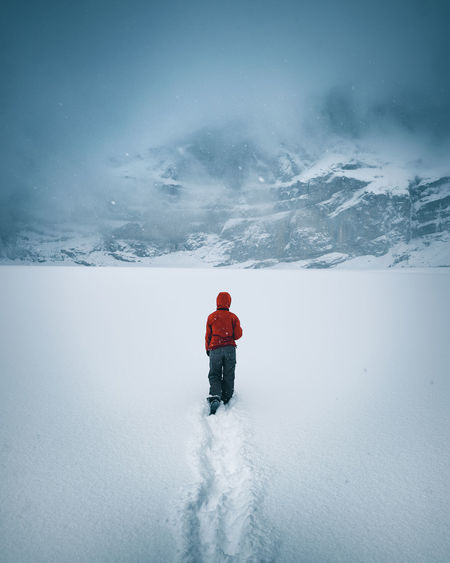 The Week On EyeEm Adventure Beauty In Nature Blizzard Cold Temperature Day Frozen Full Length Leisure Activity Lifestyles Mountain Nature One Person Outdoors People Real People Scenics Sky Snow Snowcapped Mountain Snowing Warm Clothing Weather White Color Winter Fresh On Market 2018 Go Higher