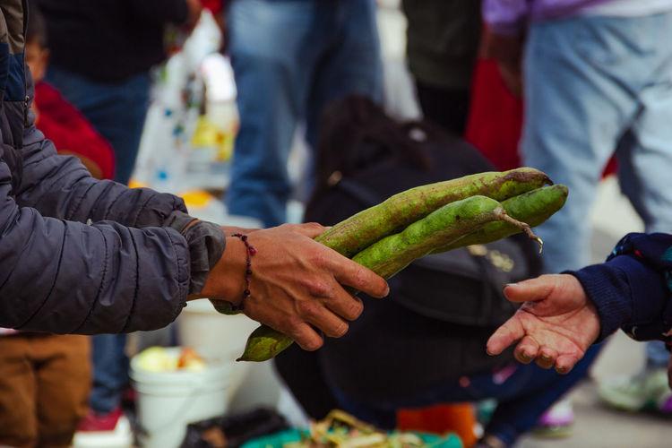 People holding ice cream in market