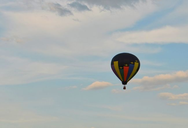 Sky And Clouds Adventure Air Vehicle Ballooning Festival Beauty In Nature Black Cloud - Sky Day Flying Hot Air Balloon Low Angle View Mid-air Multi Colored Nature No People Outdoors Parachute Paragliding Scenics Sky Sunset Transportation