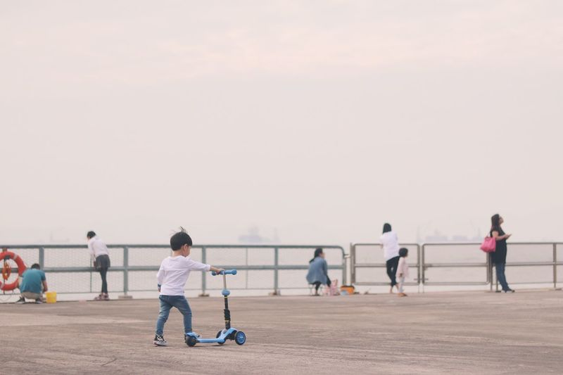 Outdoors Leisure Activity Standing Playing Childhood Child Full Length Real People Biking Bike Fun Boy