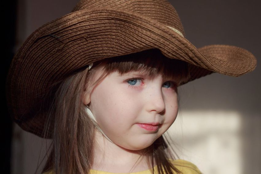 Portrait of a girl in a cowboy hat Hat Headshot Childhood Portrait One Person Girl Child Cowboy Hat Western Sunlight
