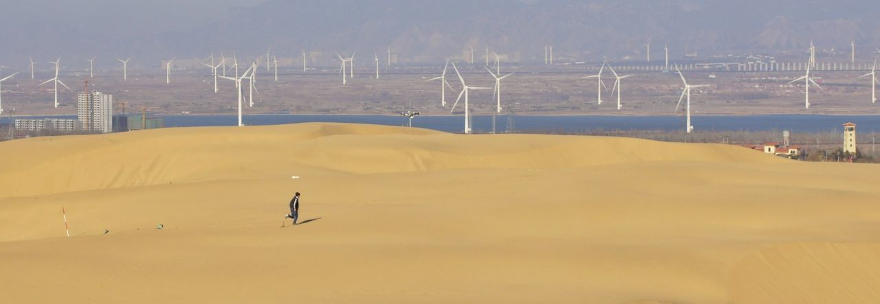 Be. Ready. Social Issues Outdoors Landscape Electricity Pylon Fuel And Power Generation Wind Turbine Day Cable Wind Power Nature Arid Climate Rural Scene Desert Mountain People Sky Sand Dune Oil Pump son of the wind
