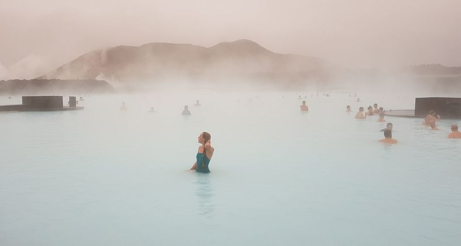 woman in blue swimsuit in blue lagoon in iceland Silica Iceland Icelandic Blue Lagoon Water Child Swimming Flood Lake Flamingo Beauty Tradition Men Sky Hot Spring Foggy Steam Volcanic Landscape Fog Mist