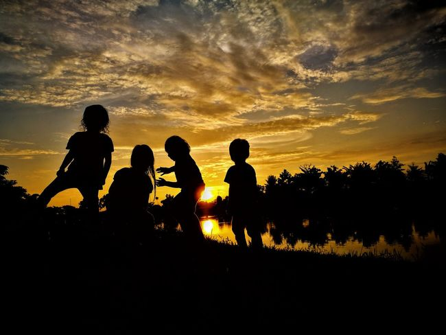 childhood Silhouetted People Childhood Child Kids Toddler  Cousin Siblings Young Burning Sky Nature Photography Landscape Sunset Silhouettes Sunset_collection Playing Headwear Sunset Togetherness Full Length Silhouette Men Friendship Sky Cloud - Sky Tranquil Scene Horizon Over Water Non-urban Scene Remote Sky Only Countryside Dusk