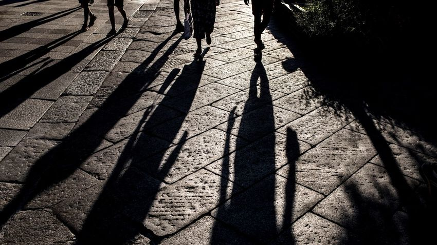 Shadow Sunlight Nature High Angle View Day Outdoors Focus On Shadow Long Shadow - Shadow City Transportation Lifestyles Real People Street Road Unrecognizable Person Pattern Footpath Land