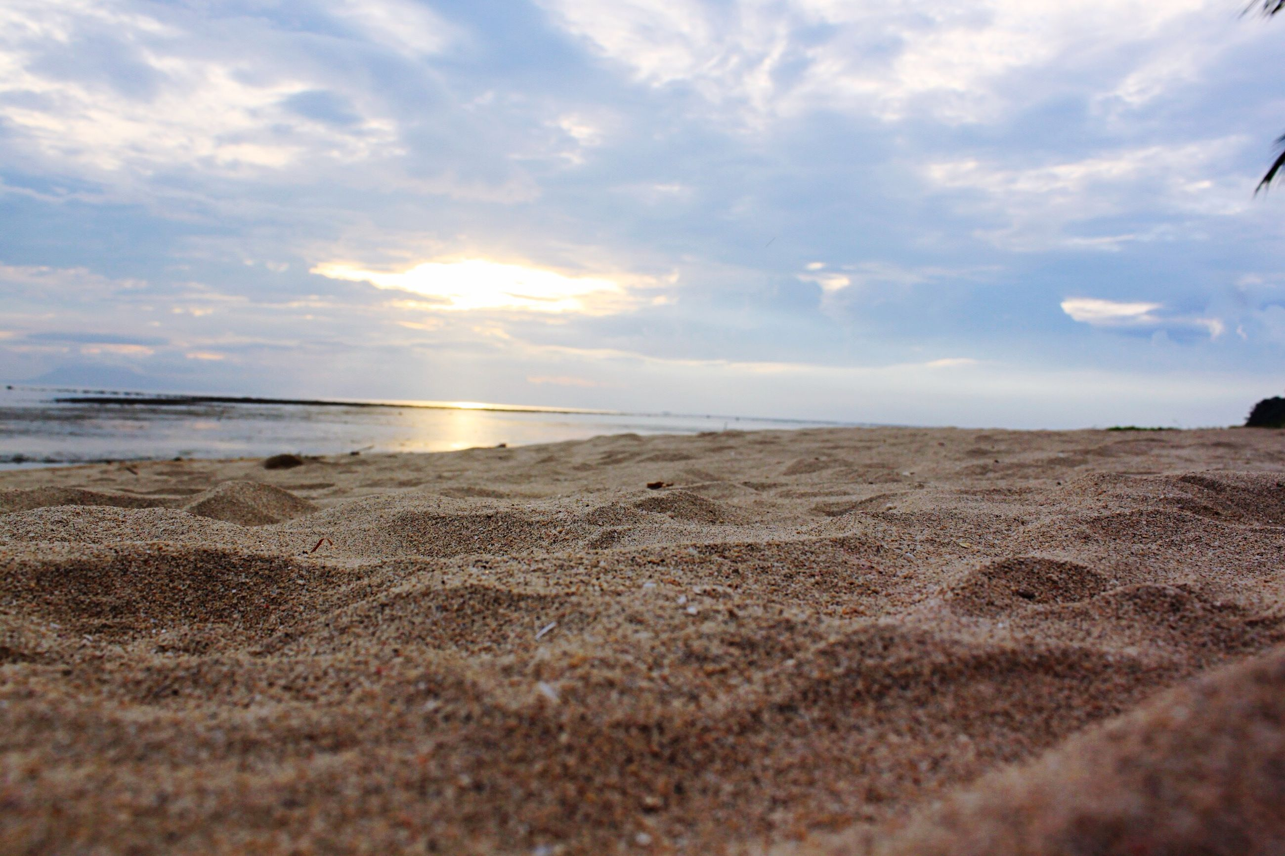 beach, sand, sky, sea, water, tranquil scene, shore, tranquility, scenics, horizon over water, beauty in nature, cloud - sky, nature, cloud, idyllic, coastline, cloudy, sunlight, reflection, calm