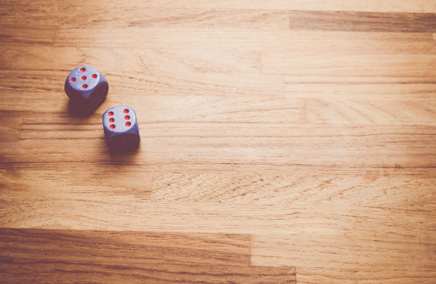 dices on a wood tabletop Balance Common Objects Control Copy Space Dices Gambling Numbers RISK Wood Background Wood Surface