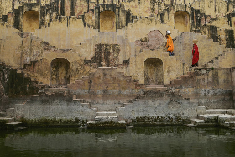 Chand Baori, Panna Meena Ka Kund. ChandBaori Jaipur Old Panna Meena Ka Kund People Rajastan Ruined Stepwell Stone Wall Water Women