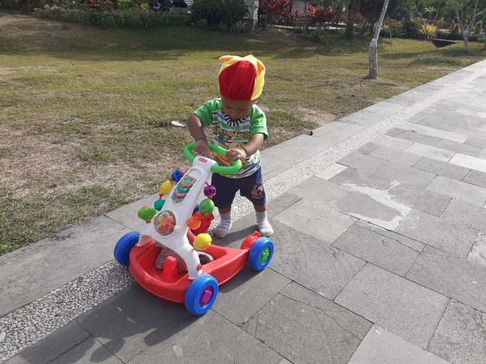 High angle view of boy riding toy car