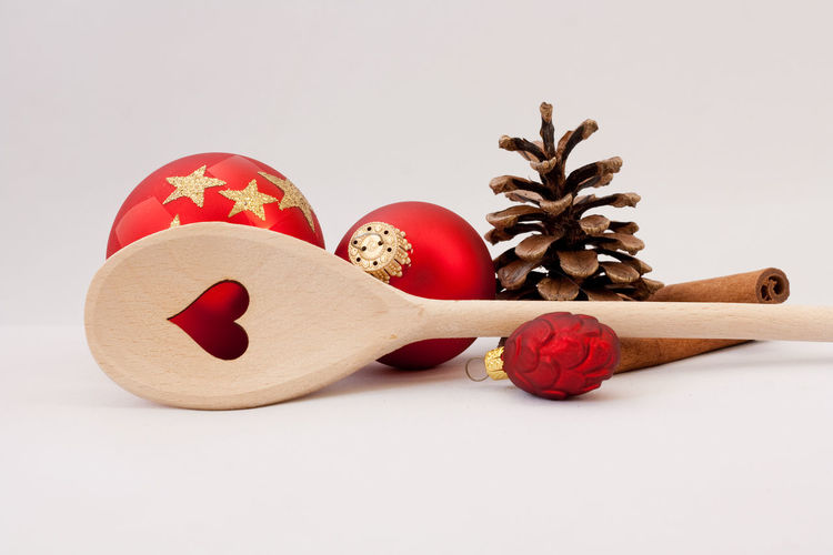 Still Life Studio Shot Indoors  White Background Food No People Close-up Decoration Creativity Copy Space Kitchen Restaurant Catering Merry Christmas! Christmas Christmas Ornament Wooden Spoon Happy Holidays! Celebration Backgrounds Pine Cone Christmas Decoration Holiday Holidays