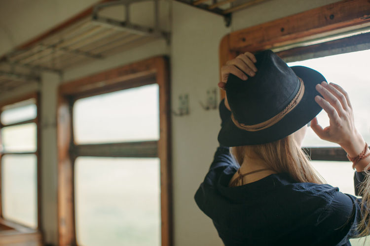 Woman wearing hat in train