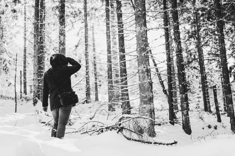 Adult Adults Only Black & White Cold Temperature Day Forest Full Length Landscape Leisure Activity Nature One Person Outdoors People Real People Snow Tree Warm Clothing Winter Young Women