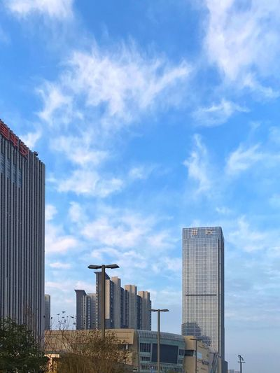 Building Exterior Architecture Built Structure Sky Cloud - Sky City Skyscraper Outdoors No People Day Low Angle View Development Modern Cityscape Building Story